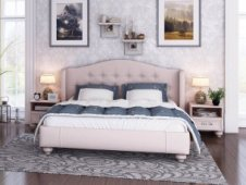 White beds with a soft headboard